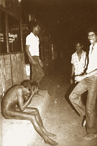 A Tamil man who was stripped and assaulted and group of young men cheering and singing bai