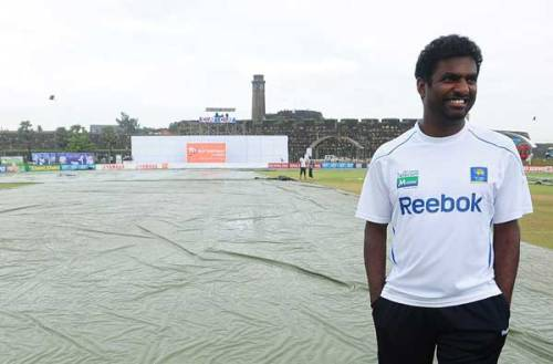 48a--A pensive Muralitharan at Galle cricket grounds -- 7-160