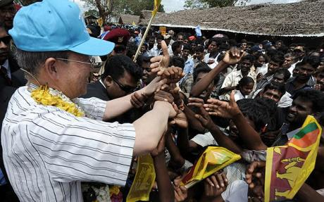 SRILANKA-UNREST-UN-BAN...U.N. Secretary-General Ban Ki-moon (r)  is greeted by IDPs (Internaly Displaced Percons) as he visits Manik Farm in Sri Lanka on May 23, 2009.   Just days after Colombo declared victory over Tamil Tiger, he toured the sprawling Menik Farm camp, 250 kilometers (155 miles) north of Colombo, which was jammed with civilians who had fled the war zone.    AFP PHOTO/JOE KLAMAR (Photo credit should read JOE KLAMAR/AFP/Getty Images)