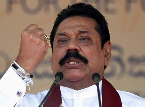 Sri Lanka's former president Mahinda Rajapaksa, who is contesting in the upcoming general election, speaks during the launch ceremony of his manifesto, in Colombo July 28, 2015. REUTERS/Dinuka Liyanawatte - RTX1M2TK