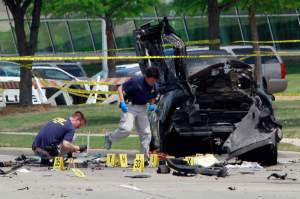 "GARLAND, TX - MAY 4, 2015 : FBI investigators work a crime scene outside of the Curtis Culwell Center in Garland, Texas on Monday, May 04, 2015 after a shooting occurred the day before on May 03, 2015 during the ""Muhammad Art Exhibit and Cartoon Contest"" in Garland, Texas. (Photo by Ben Torres/Getty Images)"