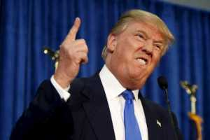 Republican presidential candidate Donald Trump gestures and declares