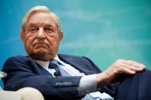"George Soros, founder of Soros Fund Management LLC, takes part in a panel discussion at the International Monetary Fund (IMF) and World Bank annual fall meeting in Washington, D.C., U.S., on Saturday, Sept. 24, 2011. The IMF said it is ready to ""strongly support"" European nations in their efforts to resolve the region's sovereign debt crisis. Photographer: Joshua Roberts/Bloomberg *** Local Caption *** George Soros"