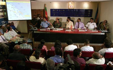 Military spokesman Brigadier Udaya Nanayakkara (2nd L) points to a diagram that he says shows the progress of the Sri Lankan army against the Liberation Tigers of Tamil Eelam (LTTE) during a news conference at the media centre for national security in central Colombo April 22, 2009. REUTERS/David Gray