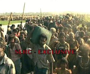 A video grab shows thousands of people the military said fled an area held controlled by the Tamil Tiger separatists in northeastern Sri Lanka on April 20, 2009. REUTERS/SLRC via Reuters TV