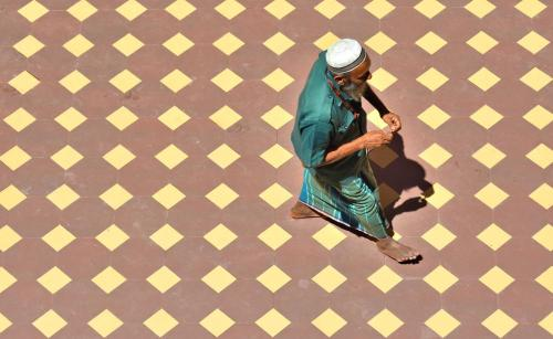 Paving patten and worshipper at the Jami Ul-Alfar Mosque in Pettah.- Ronan O'Connell