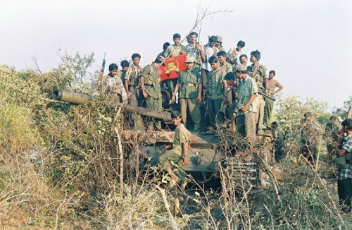 49c-Balraj with fellow fighters on a Main Battle Tank seized by the Tigers in Iththaavil