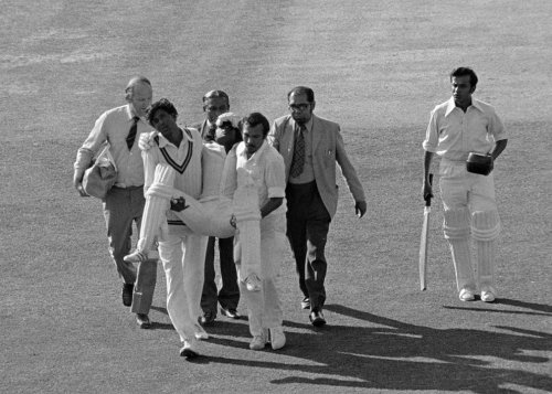 MENDIS KO he Sri Lankan batsman Duleep Mendis is carried from the field after being struck on the head by a bouncer from Australia's Jeff Thomson. Australia won by 52 runs