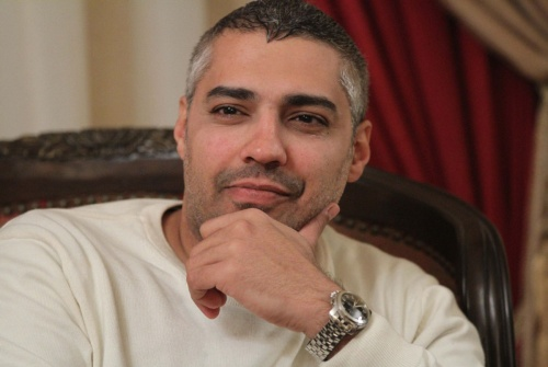 Al-Jazeera journalist Mohamed Fahmy gives an interview in Cairo on February 14, 2015 after he and his colleague Egyptian producer Baher Mohamed were released from an Egyptian jail on February 12. The ruling came after an appeals court overturned a previous jail sentence of up to 10 years handed down by a lower court that convicted them and their Australian colleague Peter Greste of aiding the banned Muslim Brotherhood. AFP PHOTO / HASAN MOHAMEDHASAN MOHAMED/AFP/Getty Images